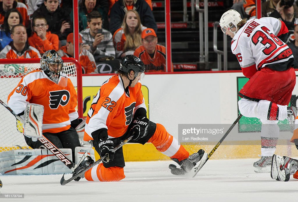 <a gi-track='captionPersonalityLinkClicked' href=/galleries/search?phrase=Luke+Schenn&family=editorial&specificpeople=4254202 ng-click='$event.stopPropagation()'>Luke Schenn</a> #22 of the Philadelphia Flyers interupts a scoring chance by <a gi-track='captionPersonalityLinkClicked' href=/galleries/search?phrase=Jussi+Jokinen&family=editorial&specificpeople=570599 ng-click='$event.stopPropagation()'>Jussi Jokinen</a> #36 of the Carolina Hurricanes on February 9, 2013 at the Wells Fargo Center in Philadelphia, Pennsylvania. The Flyers went on to defeat the Hurricanes 4-3 in OT.