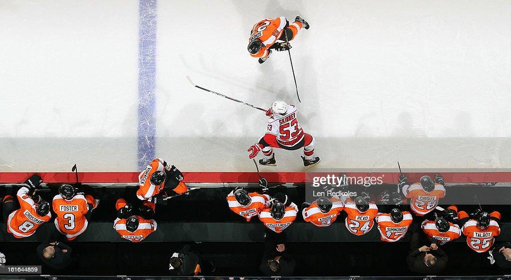 Luke Schenn #22 of the Philadelphia Flyers skates in front of the bench during a game against Jeff Skinner #53 of the Carolina Hurricanes on February 9, 2013 at the Wells Fargo Center in Philadelphia, Pennsylvania.