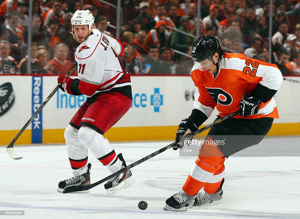<a gi-track='captionPersonalityLinkClicked' href=/galleries/search?phrase=Luke+Schenn&family=editorial&specificpeople=4254202 ng-click='$event.stopPropagation()'>Luke Schenn</a> #22 of the Philadelphia Flyers steals the puck from <a gi-track='captionPersonalityLinkClicked' href=/galleries/search?phrase=Jordan+Staal&family=editorial&specificpeople=533044 ng-click='$event.stopPropagation()'>Jordan Staal</a> #11 of the Carolina Hurricanes on February 2, 2013 at the Wells Fargo Center in Philadelphia, Pennsylvania.The Philadelphia Flyers defeated the Carolina Hurricanes 5-3.