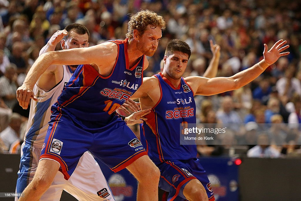 Luke Schenscher and Stephen Weigh of the 36ers hold back Will Hudson of the Breakers during the round 12 NBL match between the Adelaide 36ers and the New Zealand Breakers at Adelaide Arena on December 28, 2012 in Adelaide, Australia.