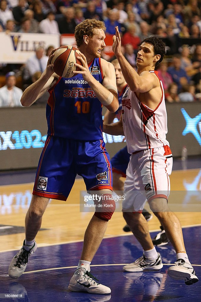 Luke Schenscher (L) of Adelaide competes with Oscar Forman (R) of Wollongong during the round 17 NBL match between the Adelaide 36ers and the Wollongong Hawks at Adelaide Arena on February 1, 2013 in Adelaide, Australia.