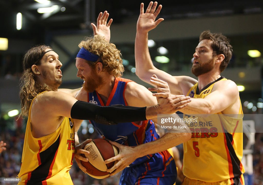 Luke Schenscher of Adelaide is put under pressure during the round 23 NBL match between the Adelaide 36ers and the Melbourne Tigers at Adelaide Arena...