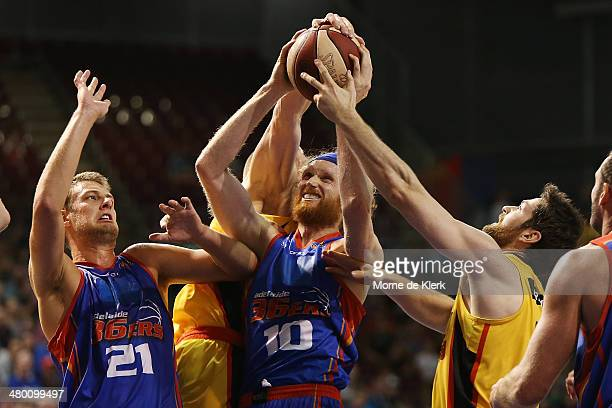 Luke Schenscher of Adelaide steals a ball during the round 23 NBL match between the Adelaide 36ers and the Melbourne Tigers at Adelaide Arena in...