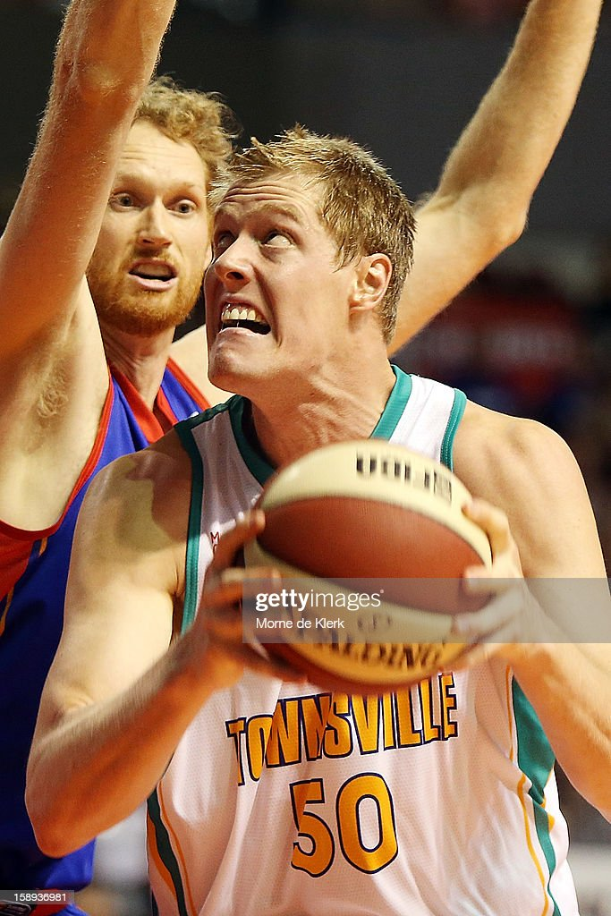 <a gi-track='captionPersonalityLinkClicked' href=/galleries/search?phrase=Luke+Schenscher&family=editorial&specificpeople=207134 ng-click='$event.stopPropagation()'>Luke Schenscher</a> of Adelaide tries to block a shot by <a gi-track='captionPersonalityLinkClicked' href=/galleries/search?phrase=Luke+Nevill&family=editorial&specificpeople=835195 ng-click='$event.stopPropagation()'>Luke Nevill</a> of Townsville during the round 13 NBL match between the Adelaide 36ers and the Townsville Crocodiles at Adelaide Arena on January 4, 2013 in Adelaide, Australia.
