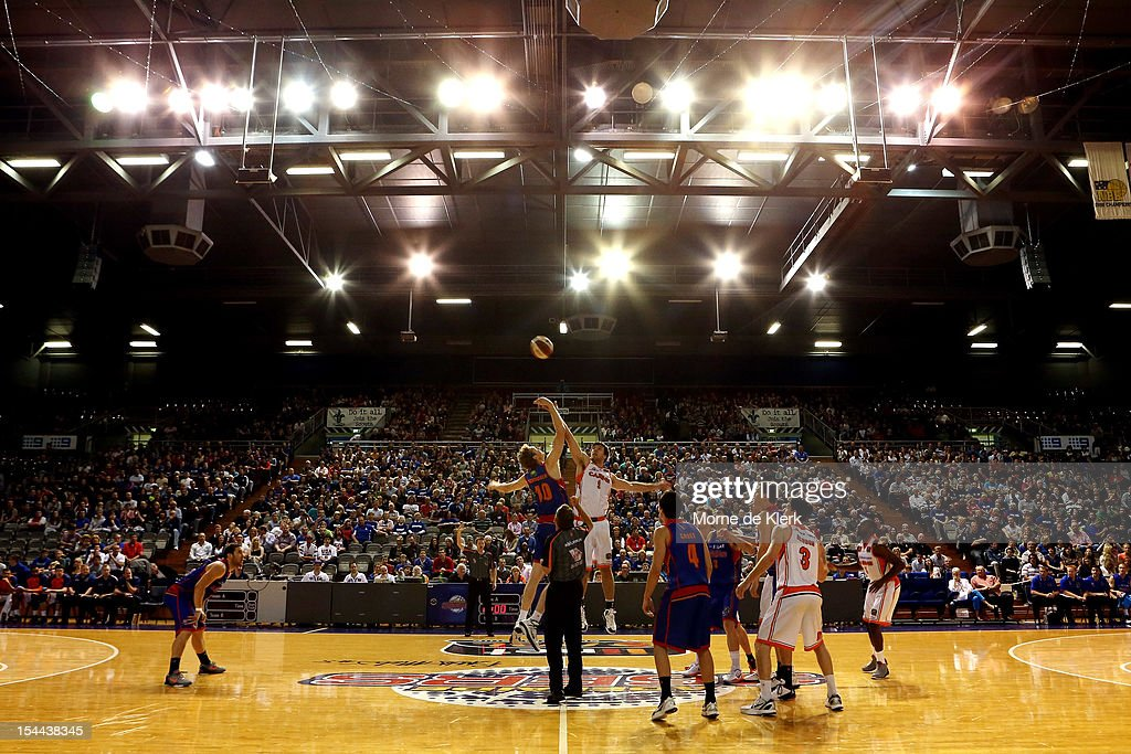 Luke Schenscher of the 36ers and Brad Hill of the Taipans compete at the tipoff during the round 3 NBL match between the Adelaide 36ers and the...