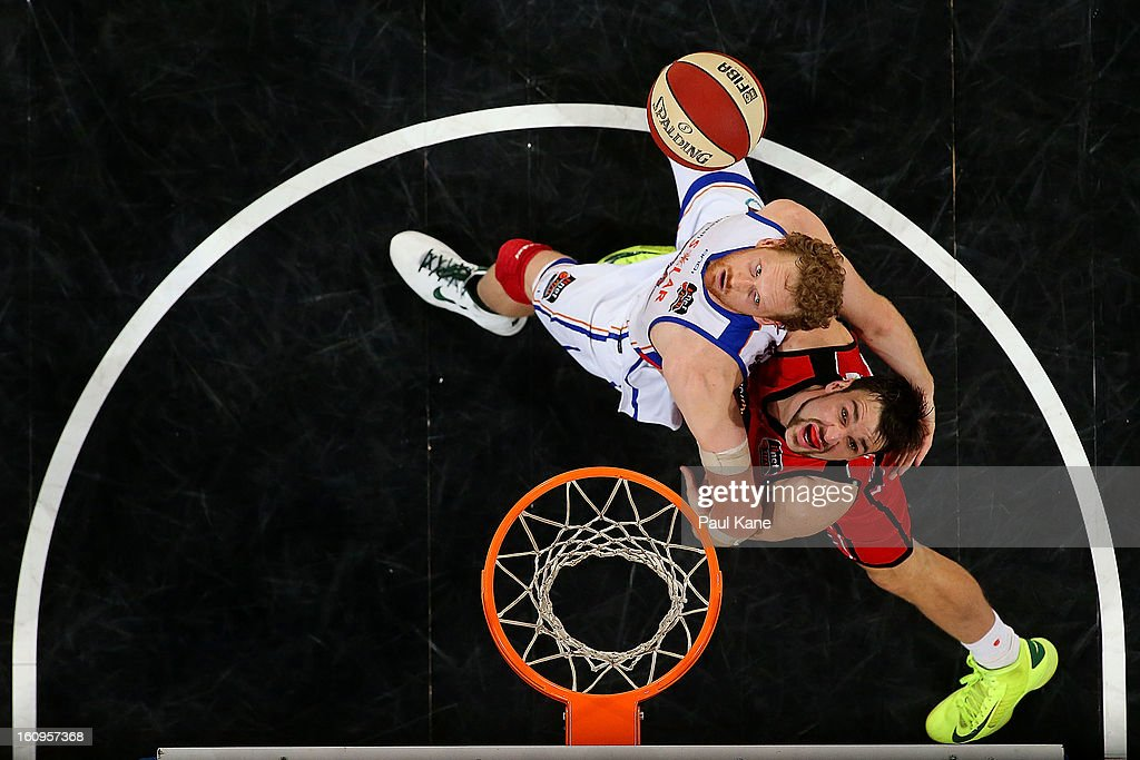 Luke Schenscher of the 36ers and Jeremiah Trueman of the Wildcats contest for a rebound during the round 18 NBL match between the Perth Wildcats and...