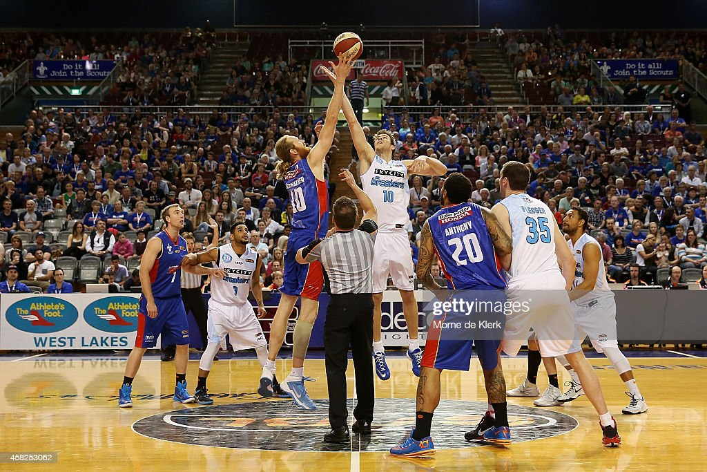 Luke Schenscher of the 36ers and Tom Abercrombie of the Breakers compete for the tipoff during the round four NBL match between the Adelaide 36ers...