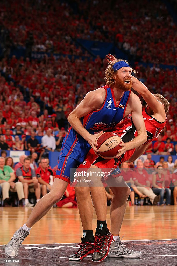 Luke Schenscher of the 36ers fouls Shawn Redhage of the Wildcats during game three of the NBL Grand Final series between the Perth Wildcats and the...