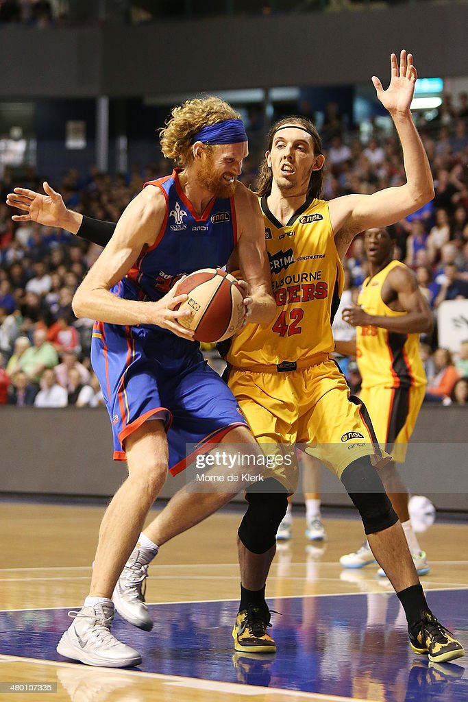 Luke Schenscher of the 36ers is blocked by Auryn MacMillan of the Tigers during the round 23 NBL match between the Adelaide 36ers and the Melbourne...