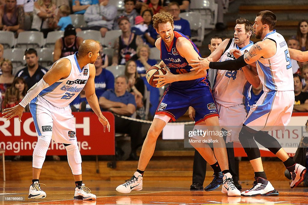 Luke Schenscher of the 36ers is put under pressure during the round 12 NBL match between the Adelaide 36ers and the New Zealand Breakers at Adelaide Arena on December 28, 2012 in Adelaide, Australia.