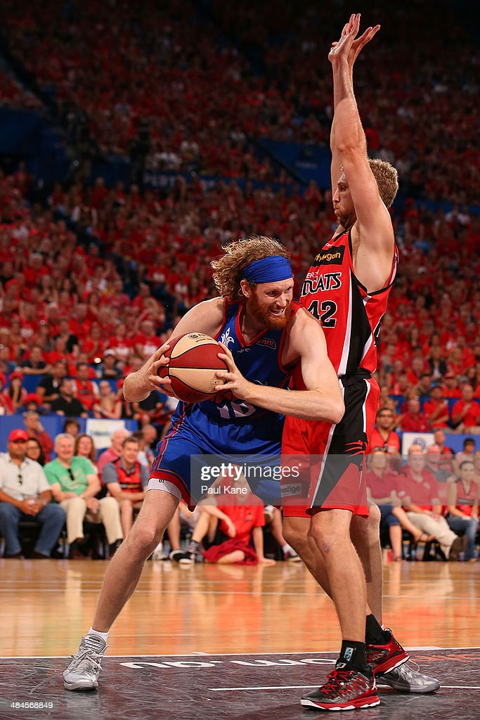 Luke Schenscher of the 36ers looks to go to the basket against Shawn Redhage of the Wildcats during game three of the NBL Grand Final series between...