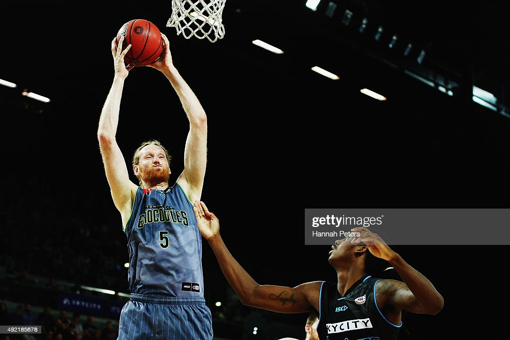Luke Schenscher of the Crocodiles lays the ball up during the round one NBL match between the New Zealand Breakers and the Townsville Crocodiles at...