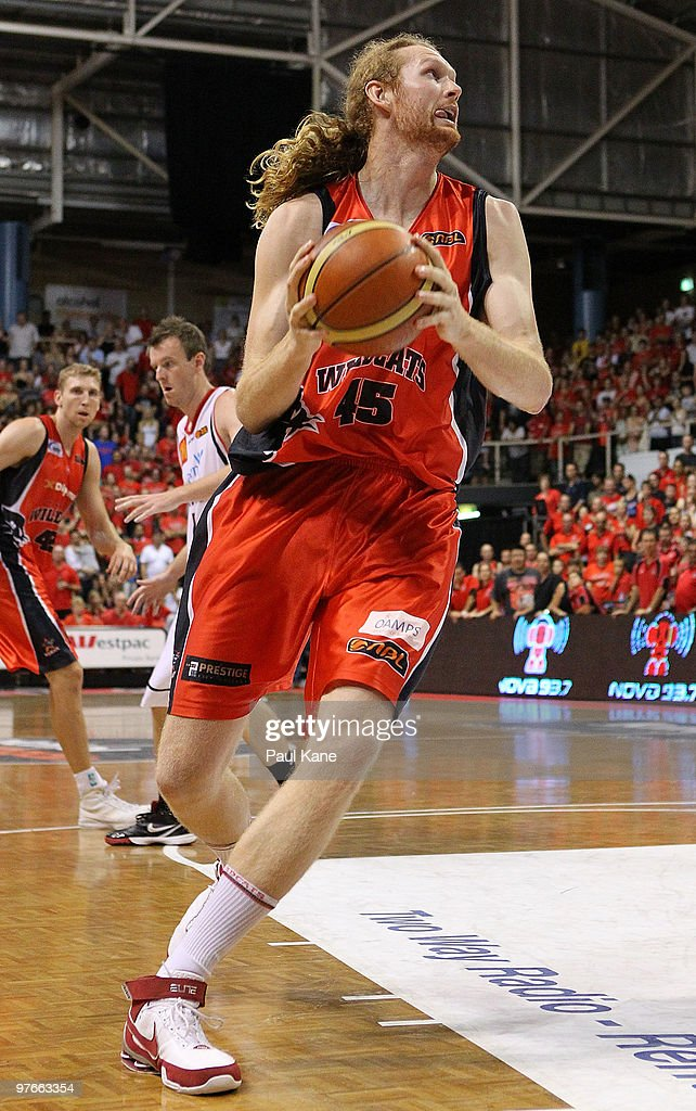 Luke Schenscher of the Wildcats drives to the basket during game three of the NBL Grand Final Series between the Perth Wildcats and the Wollongong...