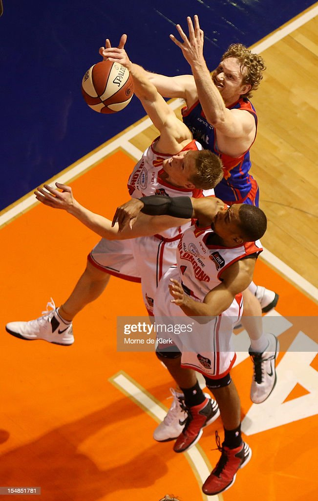 Luke Schenscher or the 36ers competes for the ball with Dave Gruber of the Hawks the ball during the round four NBL match between the Adelaide 36ers...