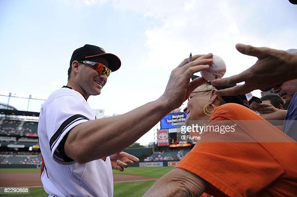 Luke Scott of the Baltimore Orioles signs autographs before the game against the Texas Rangers on August 10 2008 at Camden Yards in Baltimore Maryland