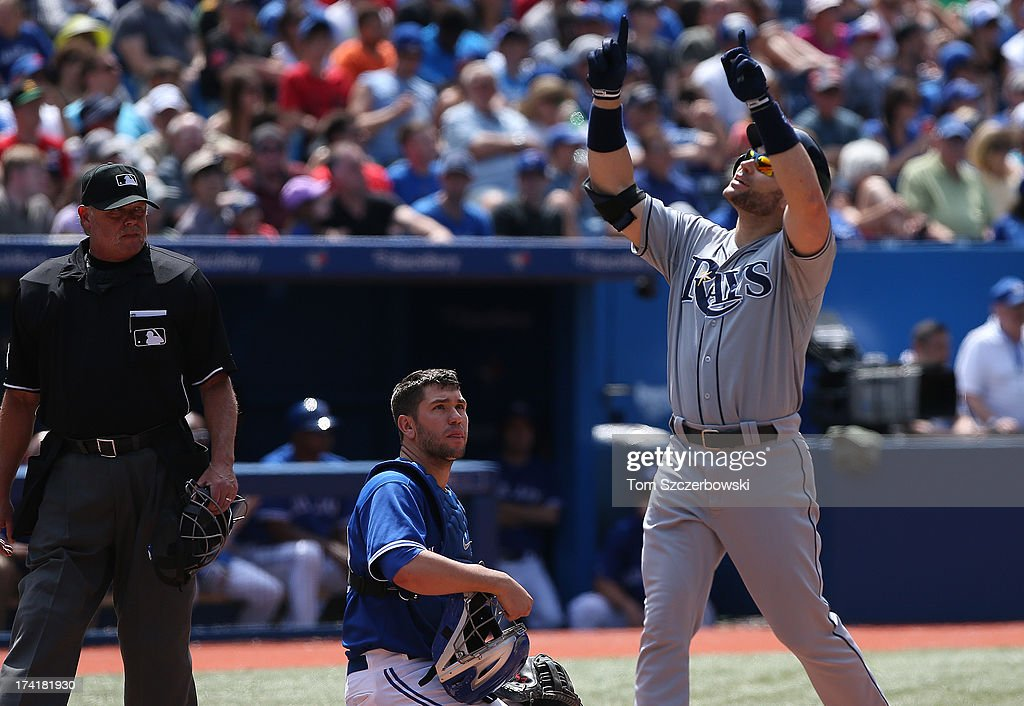 <a gi-track='captionPersonalityLinkClicked' href=/galleries/search?phrase=Luke+Scott&family=editorial&specificpeople=757156 ng-click='$event.stopPropagation()'>Luke Scott</a> #30 of the Tampa Bay Rays celebrates after hitting a 2-run home run in the sixth inning during MLB game action as <a gi-track='captionPersonalityLinkClicked' href=/galleries/search?phrase=Josh+Thole&family=editorial&specificpeople=5741573 ng-click='$event.stopPropagation()'>Josh Thole</a> #30 of the Toronto Blue Jays and home plate umpire <a gi-track='captionPersonalityLinkClicked' href=/galleries/search?phrase=Jim+Joyce+-+Umpire&family=editorial&specificpeople=194960 ng-click='$event.stopPropagation()'>Jim Joyce</a> #66 look on on July 21, 2013 at Rogers Centre in Toronto, Ontario, Canada.