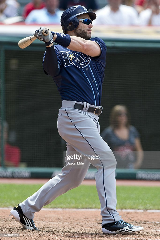 <a gi-track='captionPersonalityLinkClicked' href=/galleries/search?phrase=Luke+Scott&family=editorial&specificpeople=757156 ng-click='$event.stopPropagation()'>Luke Scott</a> #30 of the Tampa Bay Rays hits a two RBI double during the sixth inning against the Cleveland Indians at Progressive Field on July 8, 2012 in Cleveland, Ohio.