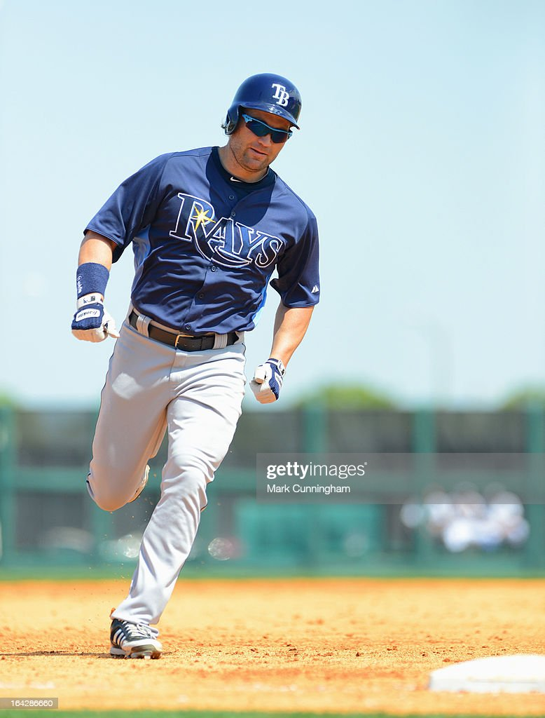<a gi-track='captionPersonalityLinkClicked' href=/galleries/search?phrase=Luke+Scott&family=editorial&specificpeople=757156 ng-click='$event.stopPropagation()'>Luke Scott</a> #30 of the Tampa Bay Rays runs the bases during the spring training game against the Detroit Tigers at Joker Marchant Stadium on March 19, 2013 in Lakeland, Florida. The Rays defeated the Tigers 11-5.