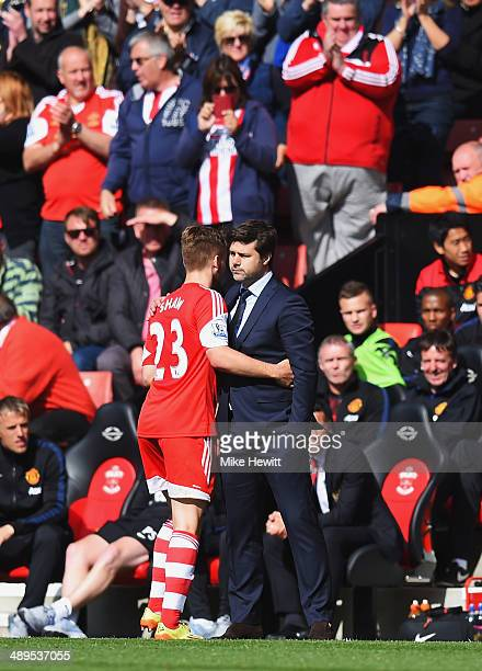 Luke Shaw embraces his Southampton manager Mauricio Pochettino during the Barclays Premier League match between Southampton and Manchester United at...
