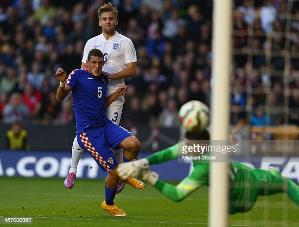 Luke Shaw of England shoots past Matej Delac of Croatia only to see his shot hit the post during the UEFA U21 Championship Playoff First Leg match...