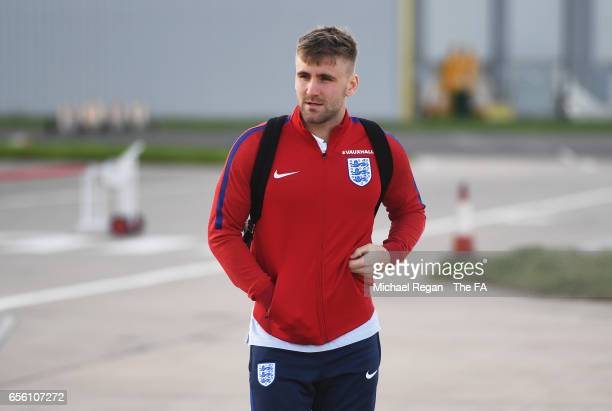 Luke Shaw of England walks to the plane as he leaves for the International Friendly match against Germany at Birmingham Airport on March 21 2017 in...