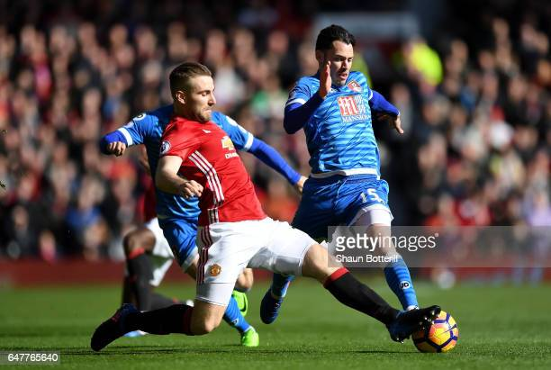 Luke Shaw of Manchester United and Adam Smith of AFC Bournemouth battle for possession during the Premier League match between Manchester United and...