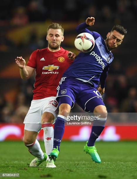 Luke Shaw of Manchester United battles with Massimo Bruno of RSC Anderlecht during the UEFA Europa League quarter final second leg match between...