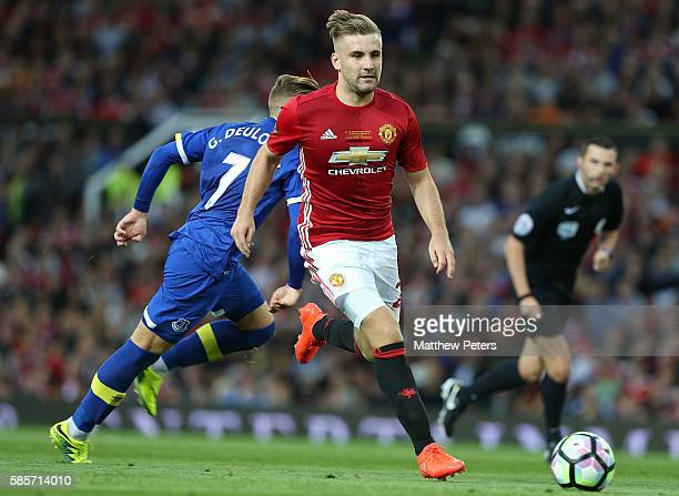 Luke Shaw of Manchester United in action during the Wayne Rooney Testimonial match between Manchester United and Everton at Old Trafford on August 3...