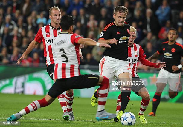 Luke Shaw of Manchester United in action with Hector Moreno of PSV Eindhoven during the UEFA Champions League match between PSV Eindhoven and...