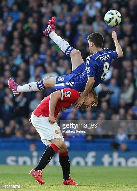 Luke Shaw of Manchester United in action with Oscar of Chelsea during the Barclays Premier League match between Chelsea and Manchester United at...