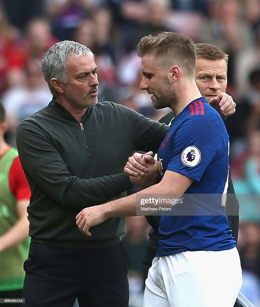 Luke Shaw of Manchester United is congratulated by Manager Jose Mourinho after being substituted during the Premier League match between Sunderland and Manchester United at Stadium of Light on April 9, 2017 in Sunderland, England.