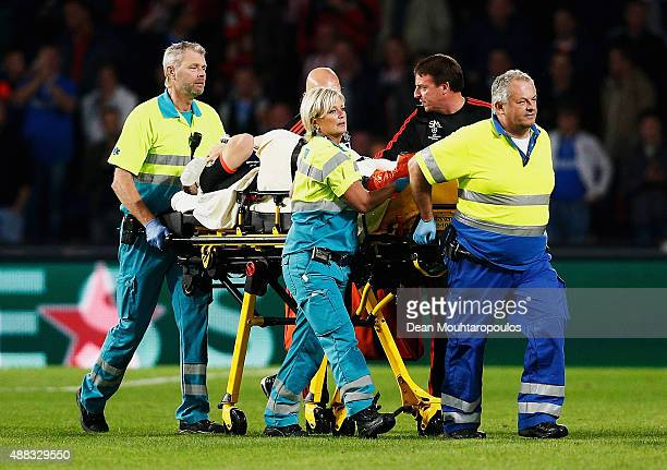 Luke Shaw of Manchester United leaves the field on a stretcher during the UEFA Champions League Group B match between PSV Eindhoven and Manchester...