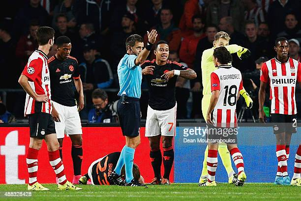 Luke Shaw of Manchester United lies on the ground injured as referee Nicola Rizzoli calls for medical assistance during the UEFA Champions League...