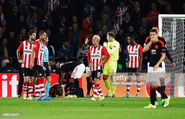 Luke Shaw of Manchester United lies on the ground injured during the UEFA Champions League Group B match between PSV Eindhoven and Manchester United...