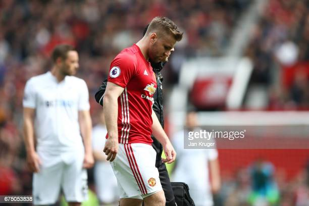 Luke Shaw of Manchester United looks dejected as he is forced off with a injury during the Premier League match between Manchester United and Swansea...