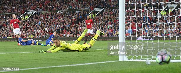 Luke Shaw of Manchester United sees his shot saved by Maarten Stekelenburg of Everton during the Wayne Rooney Testimonial match between Manchester...