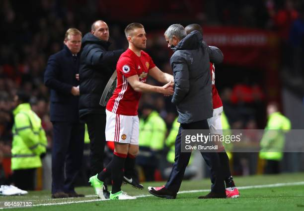 Luke Shaw of Manchester United shakes hands with Jose Mourinho Manager of Manchester United during the Premier League match between Manchester United...