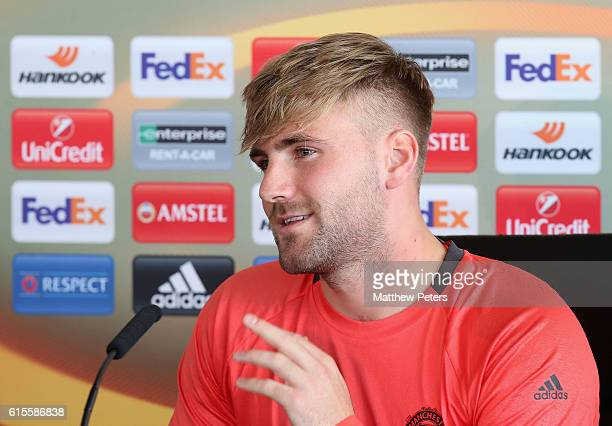 Luke Shaw of Manchester United speaks during a press conference at Aon Training Complex on October 19 2016 in Manchester England