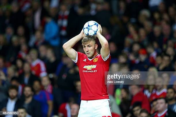 Luke Shaw of Manchester United takes a throw in during the UEFA Champions League Qualifying Round Play Off First Leg match between Manchester United...