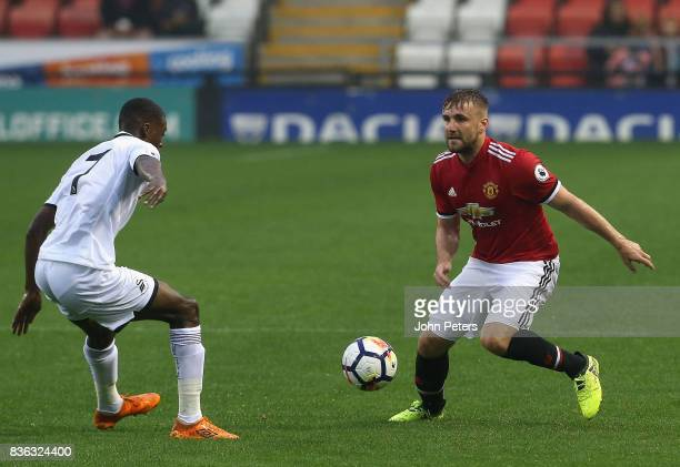 Luke Shaw of Manchester United U23s in action with Jordan Garrick of Swansea City during the Premier League 2 match between Manchester United U23s...