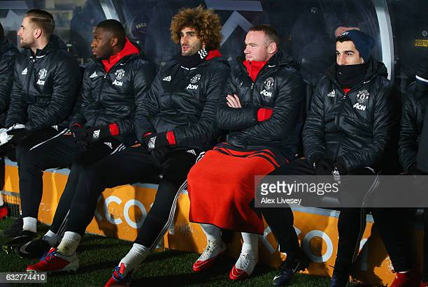 Luke Shaw Timothy FosuMensah Marouane Fellaini Wayne Rooney and Henrikh Mkhitaryan sit on the bench prior to the EFL Cup SemiFinal second leg match...