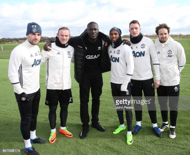 Luke Shaw Wayne Rooney Ashley Young Phil Jones and Daley Blind of Manchester United meet musician Stormzy at Aon Training Complex on March 2 2017 in...