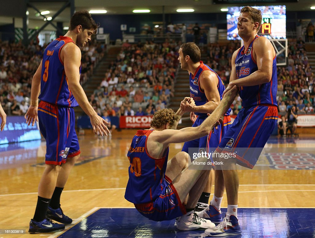 Luke Shcenscher of the 36ers is helped up by team mates during the round 18 NBL match between the Adelaide 36ers and the Melbourne Tigers at Adelaide Arena on February 10, 2013 in Adelaide, Australia.
