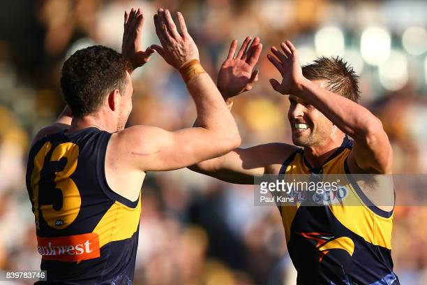 Luke Shuey and Mark LeCras of the Eagles celebrate a goal during the round 23 AFL match between the West Coast Eagles and the Adelaide Crows at...