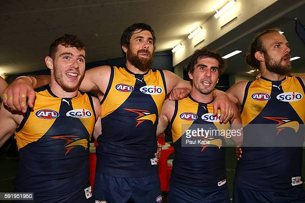 Luke Shuey Josh Kennedy Andrew Gaff and Will Schofield of the Eagles sing the club song after winning the round 22 AFL match between the West Coast...