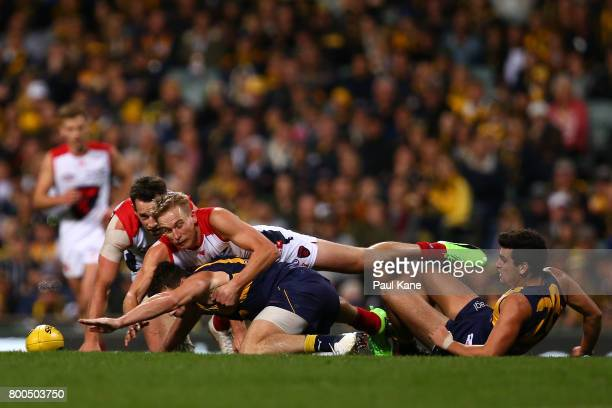 Luke Shuey of the Eagles and Bernie Vince of the Demons contest for the ball during the round 14 AFL match between the West Coast Eagles and the...