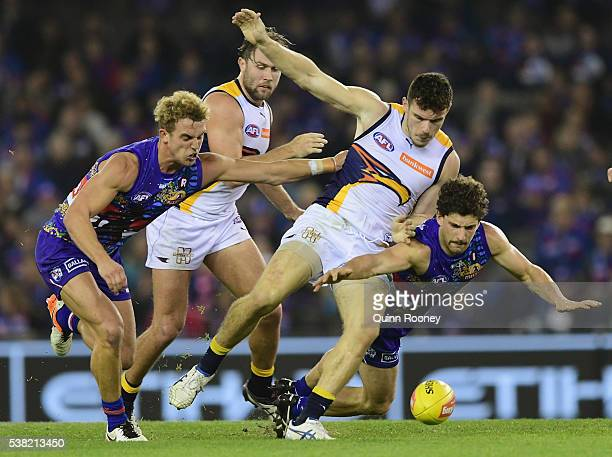 Luke Shuey of the Eagles and Tom Liberatore of the Bulldogs compete for the ball during the round 11 AFL match between the Western Bulldogs and the...