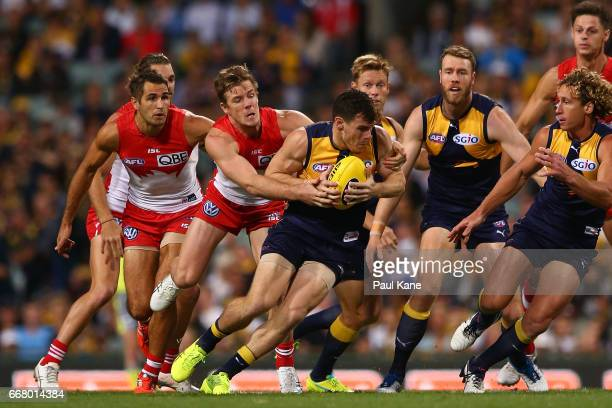 Luke Shuey of the Eagles attempts to break from a tackle by Luke Parker of the Swans during the round four AFL match between the West Coast Eagles...