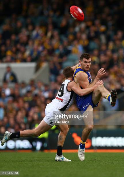 Luke Shuey of the Eagles clears the ball during the round 16 AFL match between the West Coast Eagles and the Port Adelaide Power at Domain Stadium on...