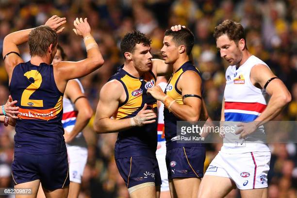 Luke Shuey of the Eagles congratulates Liam Duggan after kicking a goal during the round eight AFL match between the West Coast Eagles and the...